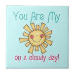 Sol en un día nublado teja cerámica