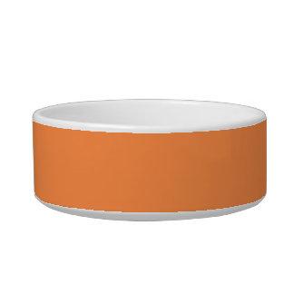 Solamente fondo bonito anaranjado del color sólido tazon para gato