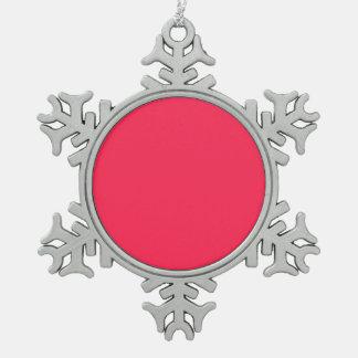 Solamente fondo bonito rosado fucsia del color adorno de peltre en forma de copo de nieve