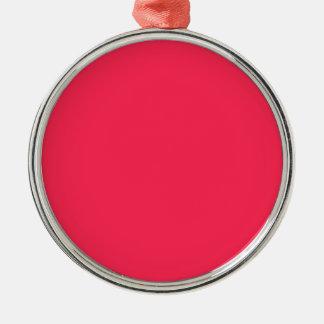 Solamente fondo bonito rosado fucsia del color adorno navideño redondo de metal