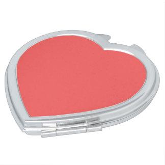 Solamente fondo femenino rosado coralino ligero espejos compactos