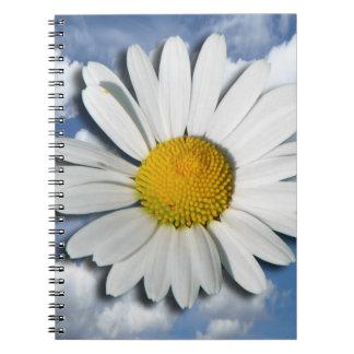 Solamente un flor de la margarita + su texto y libretas