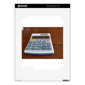 Solar calculator on a wooden table skin for the iPad 2