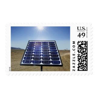 Solar panel in arid landscape postage
