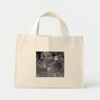 Solarized negative photograph of solo figure tote bags
