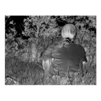 Solarized negative photograph of solo figure postcards