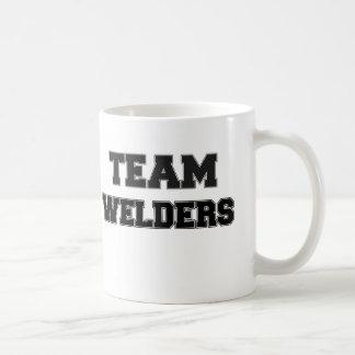 Soldadores del equipo tazas de café