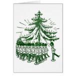 Soldados de juguete marzo alrededor de un árbol felicitación
