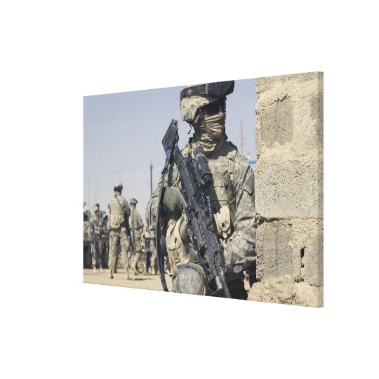 Soldier armed with a MK-48 Canvas Print