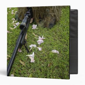 Soldier practices sniper tactics 3 ring binder
