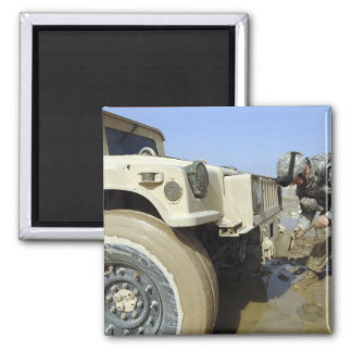 Soldier unties a rope to tow a humvee 2 inch square magnet