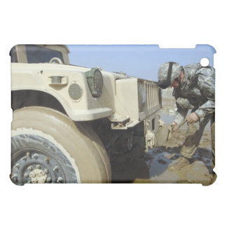 Soldier unties a rope to tow a humvee iPad mini cases