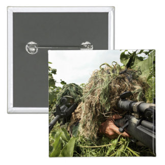 Soldiers dressed in ghillie suits button
