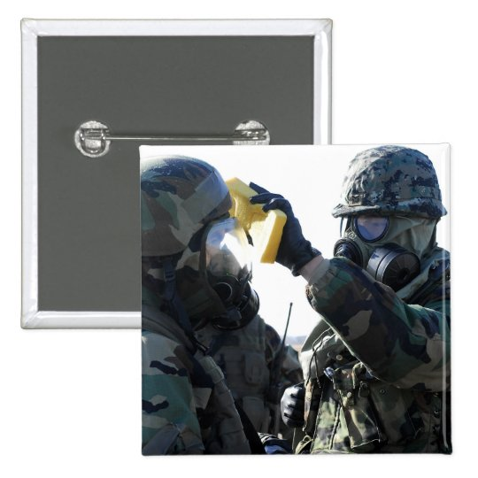 Soldiers help each other pinback button