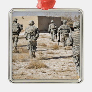 soldiers respond to a small arms attack metal ornament