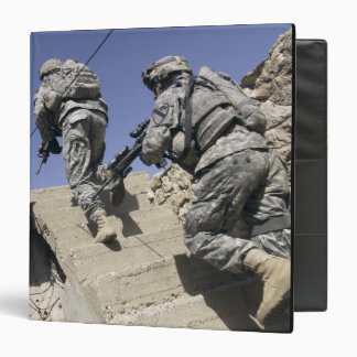 Soldiers running up staircase of a building 3 ring binder