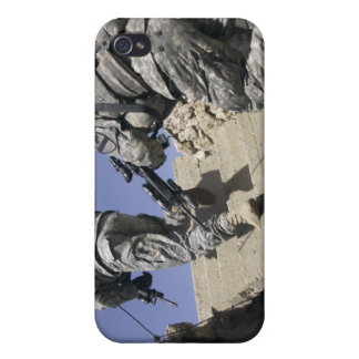 Soldiers running up staircase of a building iPhone 4 cases
