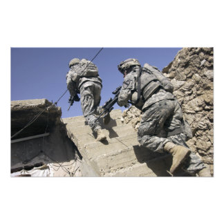 Soldiers running up staircase of a building photo