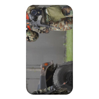 Soldiers stand guard at an intersection case for iPhone 4