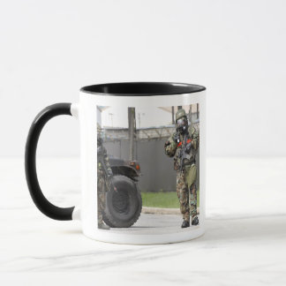 Soldiers stand guard at an intersection mug