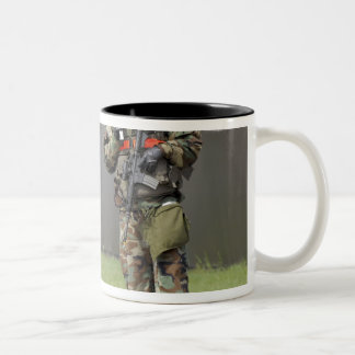 Soldiers stand guard at an intersection Two-Tone coffee mug
