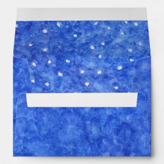 Sólido del azul real y acuarela de las nevadas sobre