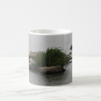 Solitary Grass Growing on Rock in Bay Coffee Mug
