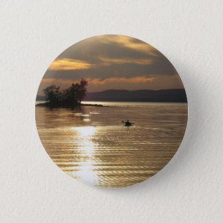 Solitary Kayak on the lake Button