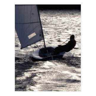 Solo Dinghy Sailing Into The Sun Postcard
