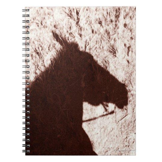 sombra de la cabeza de caballo de montar a caballo libro de apuntes con espiral