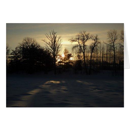 Sombras de la salida del sol del invierno tarjeta de felicitación