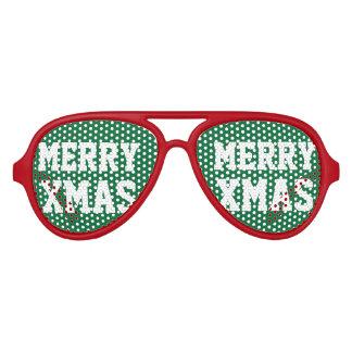 Sombras rojas verdes del fiesta de Navidad de las Lentes De Sol