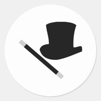 sombrero de copa del mago y vara de la magia pegatina redonda