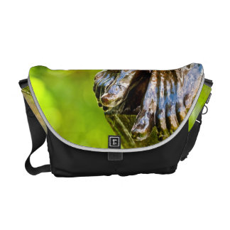 some believe in green courier bag