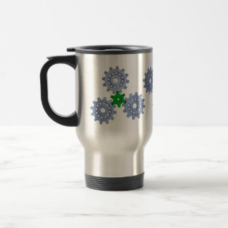 Some silver gears with a little green travel mug