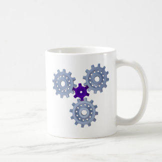 Some silver gears with a little purple coffee mug