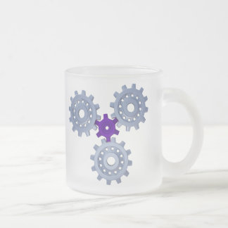 Some silver gears with a little purple frosted glass coffee mug