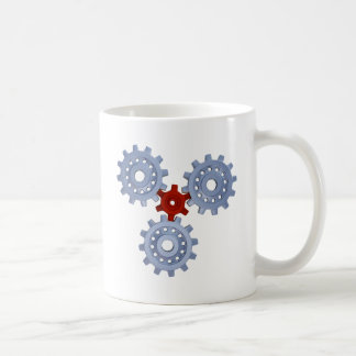 Some silver gears with a little red coffee mug