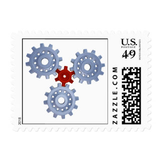 Some silver gears with a little red postage stamp