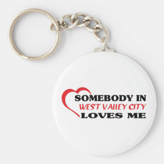 Somebody in West Valley City loves me t shirt Keychains