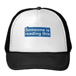 Someone is reading trucker hat
