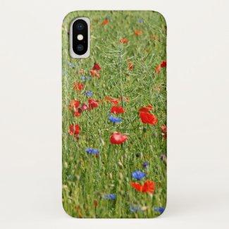 Sommerfeld mit roten und blauen Blumen iPhone X Case