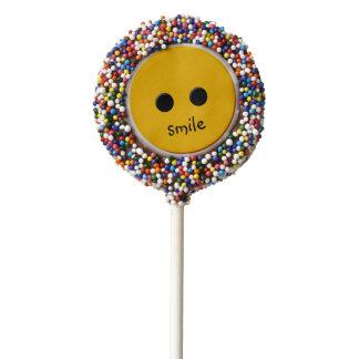 sonrisa como los dulces de un botón