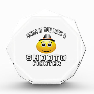 Sonrisa si usted ama el combatiente de SHOOTO