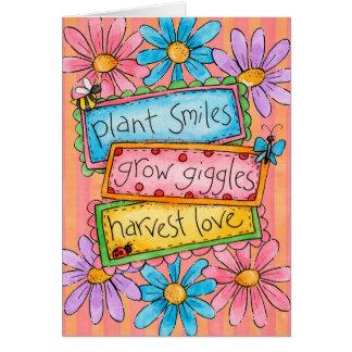 Sonrisas de la planta tarjeta de felicitación