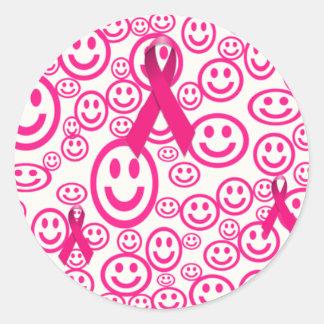 Sonrisas rosadas de la cinta que ayudan pegatina redonda