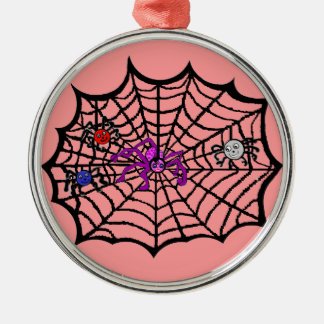 Sophie the Spider caught in her web Round Metal Christmas Ornament
