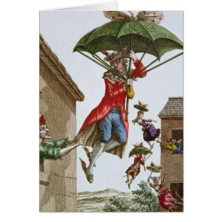 Sostenido en alto por los paraguas y las mariposas tarjetas