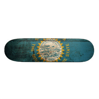 South Dakota State Flag on Old Wood Grain Skateboard