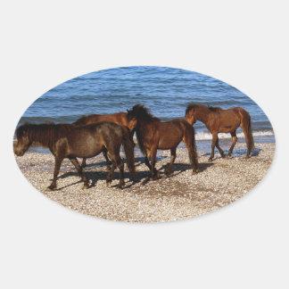 South Devon Four Dartmoor Ponies On Remote Beach Oval Sticker